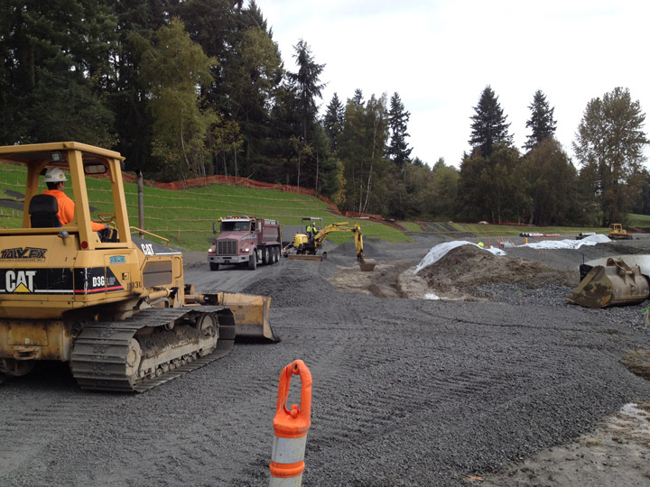 Construction crews operate heavy machinery equipment around the 33rd Avenue West ring road to install a new water main loop on the old Lynnwood High School site.